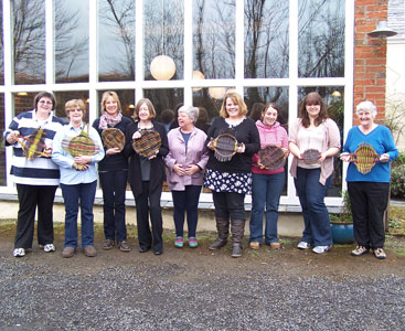Image of students showing their beautiful willow platters on a Country Craft Taster Weekend at Creative Craft Retreats