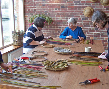 Image of students preparing freshly cut willow on a Country Craft Taster weekend at Creative Craft Retreats