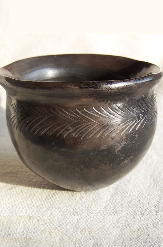 Image of a Sawdust Fired Pot with Sgraffito decoration